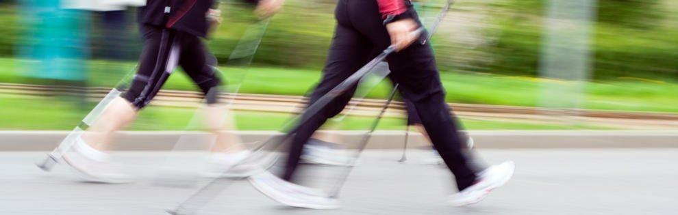 Womans walking on Nordic walking race in city