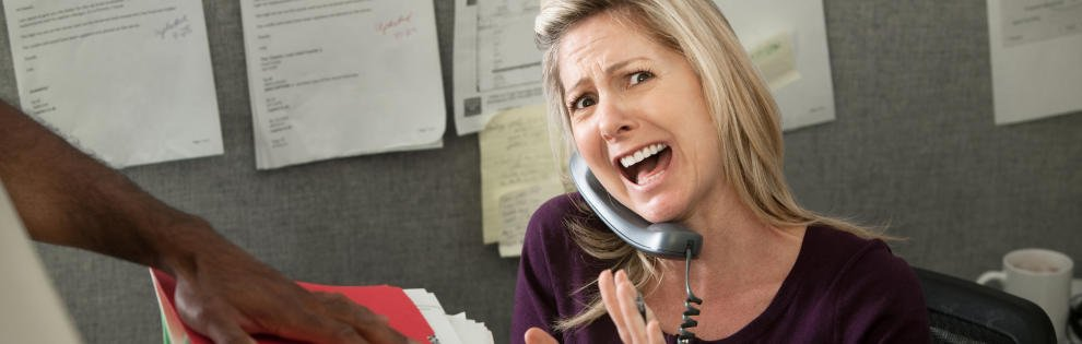 Woman office worker yells on a phone call