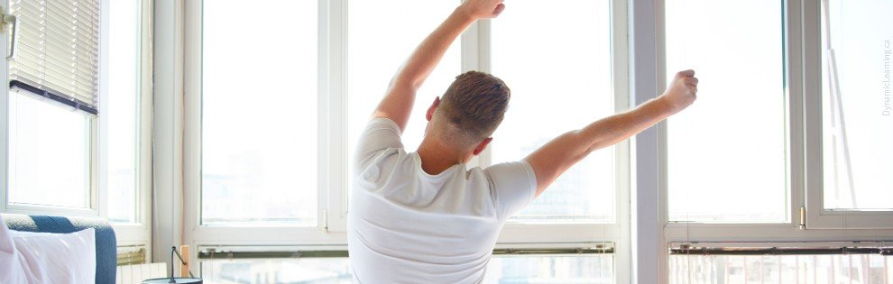 man waking up in the morning and stretching