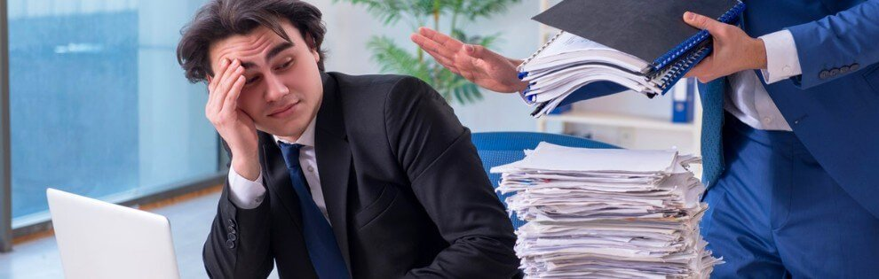 man stressed at workload