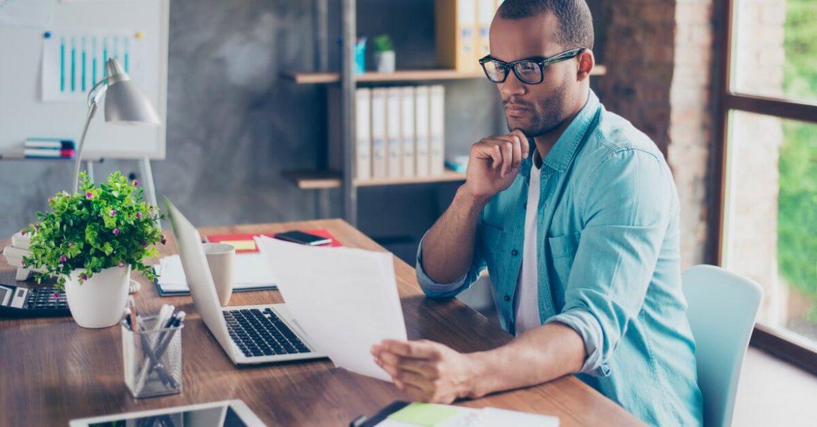 man rading at desk